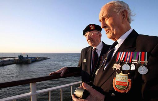 Normandy veterans Frank Allen, 85, and Cyril Askew, 92, both from Liverpool, look at the French coastline as they approach Caen