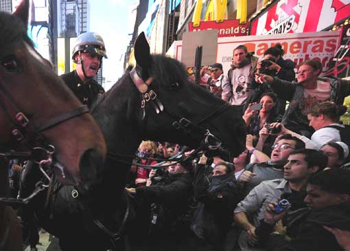 Mounted police try to stop Occupy Wall Street participants from breaking through barricades and spilling onto the street at Times Square in New York on Oct. 15. Thousands of demonstrators protesting corporate greed filled Times Square and dozens were arrested.
