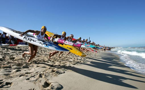 competitors run to the water during the start of the Open Women's Board Race final, 2009 Australian Surf Lifesaving Championships