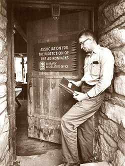 Paul Schaefer opens the doors to the Library and Legislative Headquarters of the Association for the Protection of the Adirondacks in 1963. As an 11-year-old boy in 1919, Paul Schaefer made his unflagging commitment to the wilderness until his death in Schenectady in 1997 at the age of 87. Schaefer preserved the memento of that occasion in a leather change purse. In the decades between, this son of the Mohawk Valley worked to protect and preserve wilderness tirelessly.