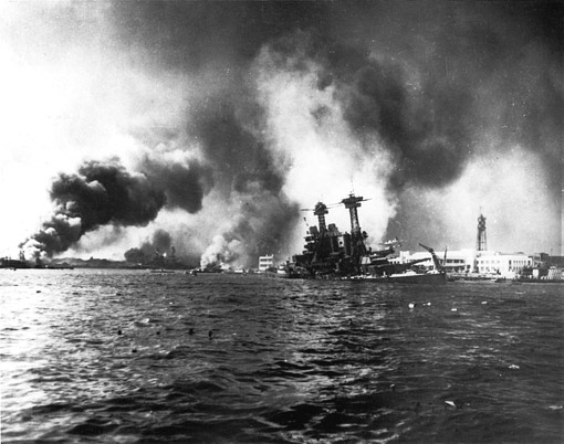 The U.S. Navy battleship USS California (BB-44) slowly sinking alongside Ford Island, Pearl Harbor, Hawaii (USA), as a result of bomb and torpedo damage, 7 December 1941.