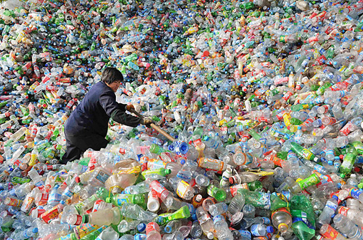 suffocating in sea of plastic: a worker sorts plastic bottles at a recycling centre in Hefei, China