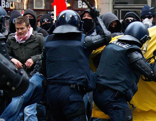 demonstrators clash with riot police during a protest against the Davos World Economic Forum in Geneva, Switzerland, Jan. 31, 2009