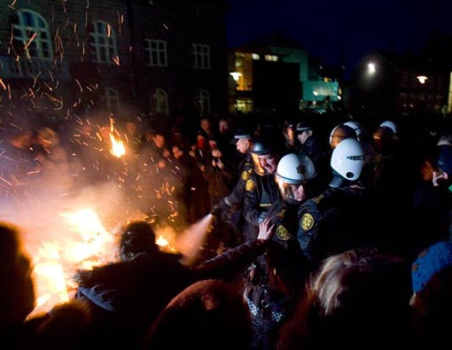 protesters clash with police during a demonstration in Reykjavik, Iceland