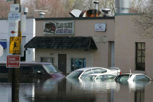 cars and businesses surrounded by flood waters in West Warwick, Rhode Island