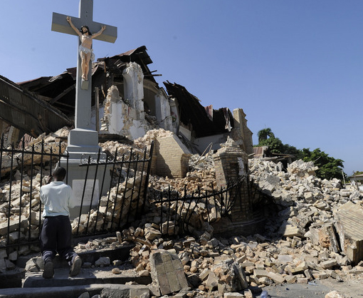 Jeune Joseph Andre Ronaid prays at the remains of Sacre Couer church in Port-au-Prince, Haiti. 'The church is not collapsed, it is within us,' he said.