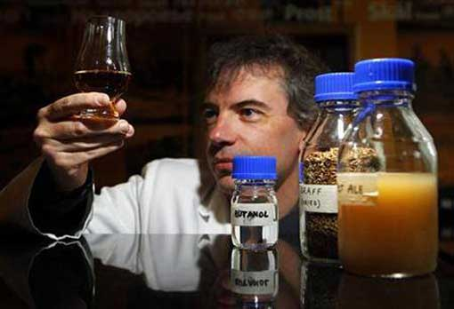 Professor Martin Tangey, Director of Edinburgh Napier University Biofuel Research Centre, holds a glass of whisky during a media viewing in Edinburgh, Scotland