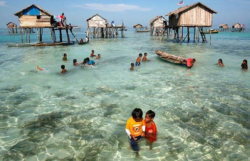sea gypsies build houses on stilts in coastal shallows