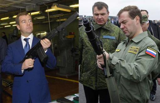 Russian President Dmitry Medvedev holds a Kalashnikov gun