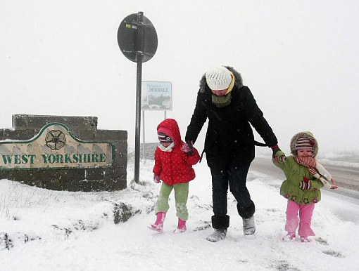 Brrrrr: A young family plays in the snow at Saddleworth, West Yorkshire as the driving snow turns the countryside white. Freezing temperatures and heavy snow sweep across Britain and much of Northern Europe. Michael Dukes, forecast manager for MeteoGroup UK, said the cold snap was set to continue for the next few days, although it was not yet known if milder weather would move in before or after Christmas. North-west England, the Pennines, Scotland and Northern Ireland saw the worst of the snow today. 'This is very cold Arctic weather from the North Sea,' he said.