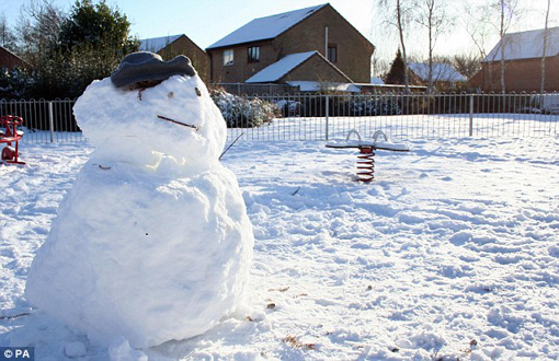 A snowman in Chapel Break, Norwich, UK this afternoon - Dec. 20, 2009. Many homes have been without power since Thursday night as a result of the runway of snow.