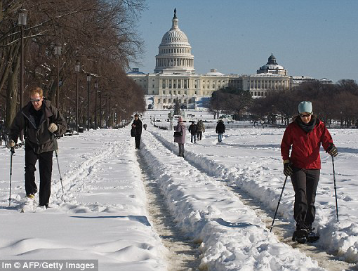 People used skis and snowshoes on the National Mall near the US Capitol in Washington Sunday.