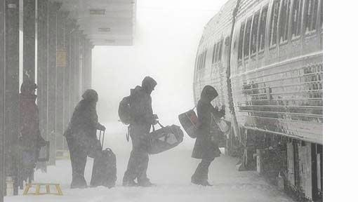 commuters board a delayed train to New York City during a snowstorm in Depew, New York