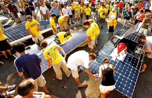 solar powered cars line up at the start of the World Solar Challenge in Darwin