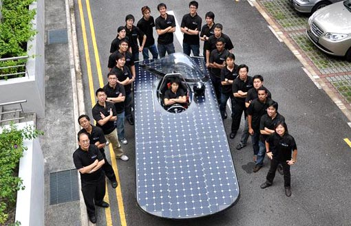 the crew from the Nanyang Technological University in Singapore gather around their car, the Nanyang Venture II