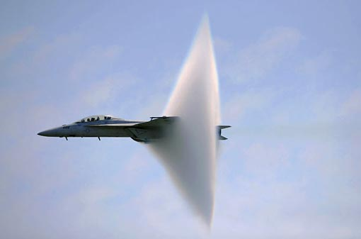 ring of water forms in the air as Super Hornet hits the speed of sound