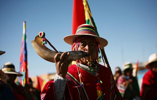 supporters of Bolivia's President Evo Morales march towards La Paz, in the village of San Antonio, Bolivia, Sunday, Oct. 19, 2008