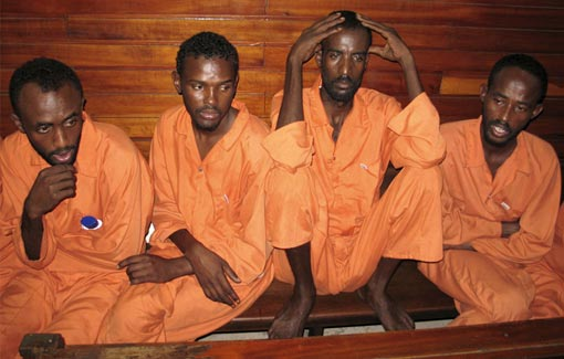 suspected Somali pirates sit in a court of law in Kenyan coastal town of Mombasa