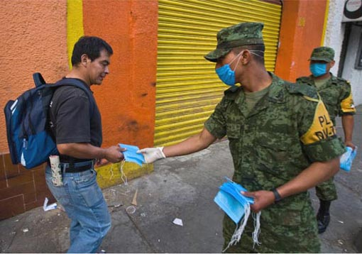 Mexican army giving out face masks as prevention against the swine flu virus