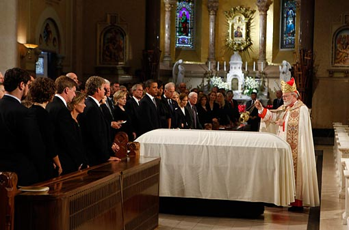 Cardinal Sean O'Malley, Archbishop of Boston, walks around casket of Sen. Ted Kennedy - faithful Catholic & Lion of the Senate, politician fighting legislative battles on behalf of the less fortunate - with incense before it leaves the church