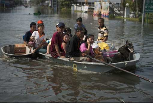 More than 300 people have been killed in floods throughout Northern Thailand from months of heavy monsoon rains. Local residents sit on a boat in floodwaters as they leave their homes with their animals and belongings in Bang Bua Thong in Nonthaburi province, suburban Bangkok, on Oct. 19, 2011.