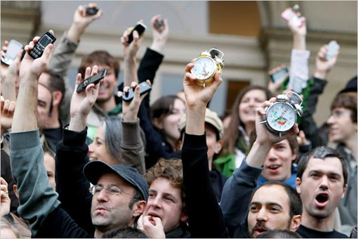 To signal that time is running out for a warming planet, French activists clutched alarm clocks and mobile phones at a protest at the Bourse, the former stock exchange in central Paris.