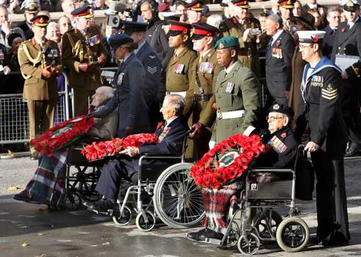 Britain's oldest World War I war veterans, Henry Alingham, 112 years old, (L), Harry Patch, 110 years old, (C) and Bill Stone (R) attend the Armistice Day service at the Cenotaph in London, Britain, 11 November 2008. Three of four surviving British veterans of World War I were present to mark the 90th anniversary of the end of World War I.