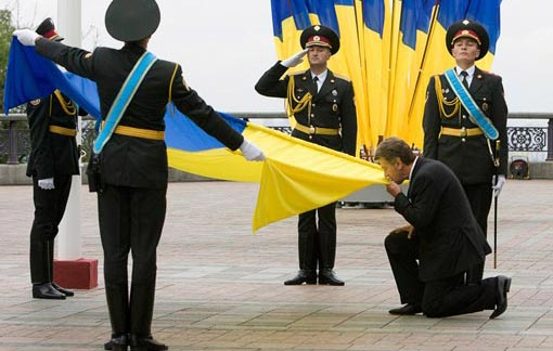 Ukraine's President Viktor Yushchenko kisses the Ukrainian National flag in Kiev, Ukraine, Sunday, Aug. 23, 2009, as he attends the State Flag Day.