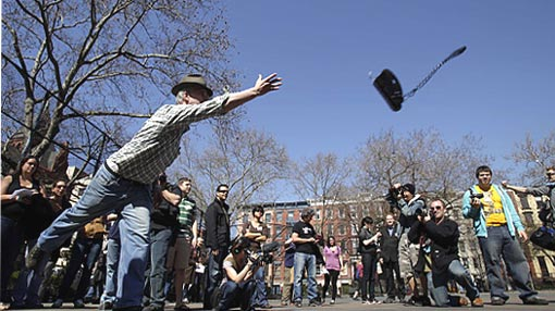 Howard Henson, an unemployed financial IT recruiter, tosses a phone during the Unemployment Olympics in New York, Tuesday, March 31, 2009