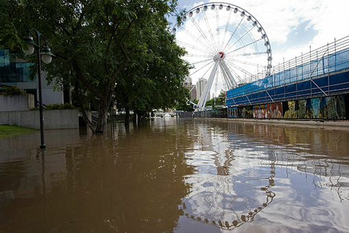 Floodwater surrounds the Wheel of Brisbane at South Bank on January 13 2011