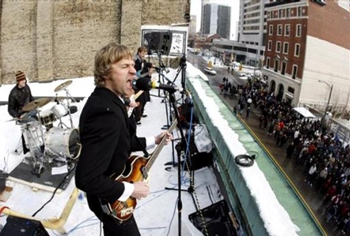 organizer Yuri Pool, center, leads a group of musicians as they on a rooftop in London, Ont., Friday Jan. 30, 2009, recreating the Beatles final public concert 40 years ago Friday