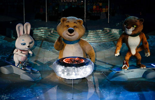 2014 Sochi Winter Olympic Mascots extinguish Olympic flame during the closing ceremony