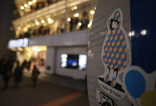 A sticker art made by an artist known as 281 Antinuke, is seen on the back of a traffic signboard on a street in Tokyo Nov 26, 2013