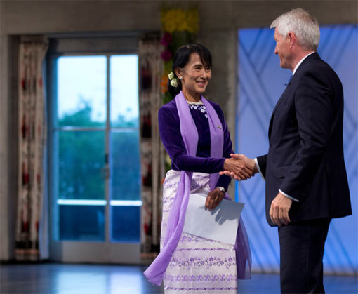 Aung San Suu Kyi, the Burmese opposition leader, is greeted in Oslo by Thorbjorn Jagland, chairman of the Norwegian Nobel Committee