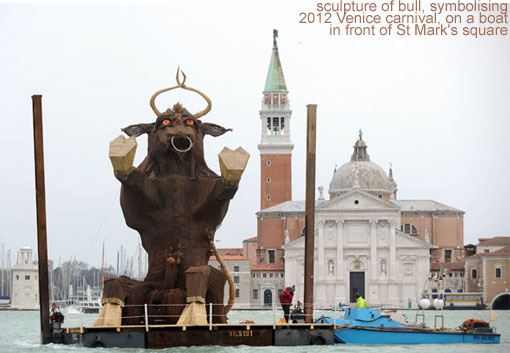 A sculpture of bull, symbolising the 2012 Venice carnival, is carried on a boat in front of St Mark's square