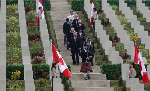 Visiting Canadian Prime Minister Stephen Harper and wife Laureen walk down the stairs with World War Two veterans at Sai Wan War Cemetery as they attend a Remembrance Day ceremony in Hong Kong
