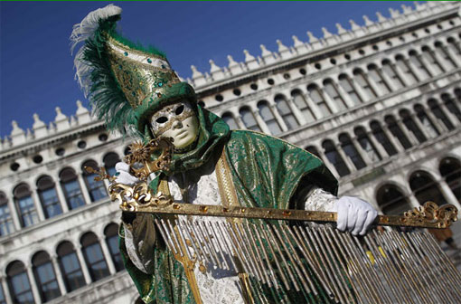 A masked reveller poses in Saint Mark's Square during the Venetian Carnival