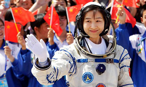 China's first female astronaut, waves during a launch ceremony at Jiuquan Satellite Launch Centre