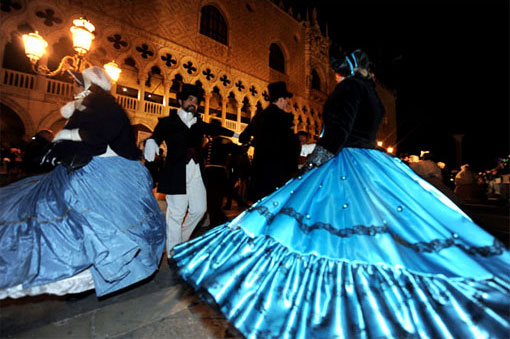 People dance in costumes Venice's Saint Mark's Square