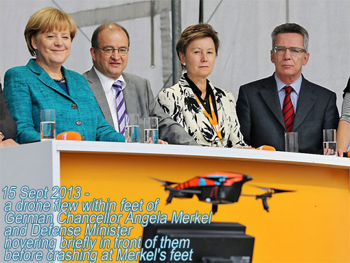 a drone flew within feet of German Chancellor Angela Merkel and Defense Minister, hovering briefly before crashing at Merkel's feet