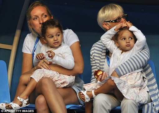 Two-year-old Myla Rose and her sister Charlene Riva looked adorable as they cheered their father Roger Federer on during his warm-up at the Australian Open