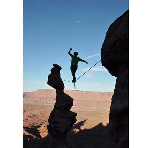 slackliner high above the ground in Utah's Moab Desert