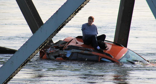 bridge collapse: into river but atop the car