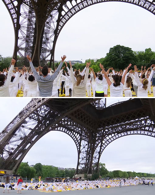 >1,500 people take part in yoga at the Eiffel Tower in Paris to celebrate first ever International Day of Yoga