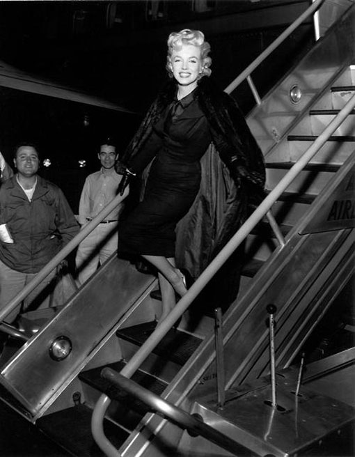 Marilyn photographed arriving back in Hollywood before a press conference in the airport lounge, February 25, 1956