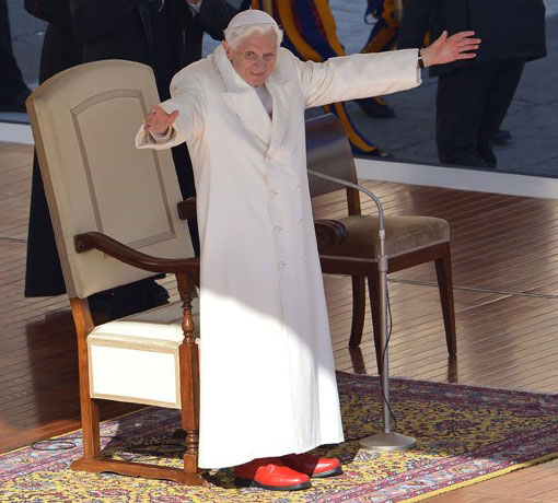 Pope Benedict waves from the altar as he arrives in St Peter's square for his last weekly audience