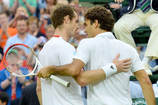 Andy Murray, left, and Roger Federer share a moment together after their hard-fought, four-set match in the Wimbledon men's final on Sunday