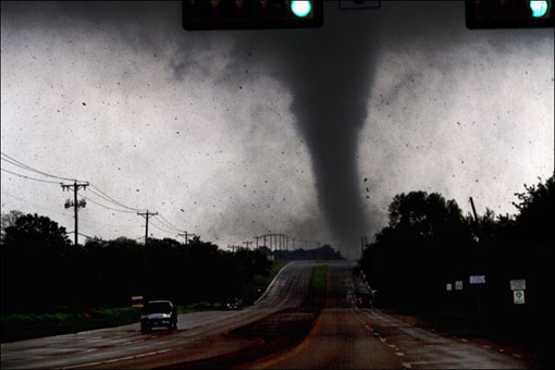 A tornado touches down in Lancaster, Texas south of Dallas on Tuesday, April 3, 2012. Tornadoes tore through the Dallas area Tuesday, peeling roofs off homes, tossing big-rig trucks into the air and leaving flattened tractor trailers strewn along highways and parking lots